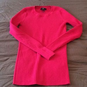 Hot pink sweater.